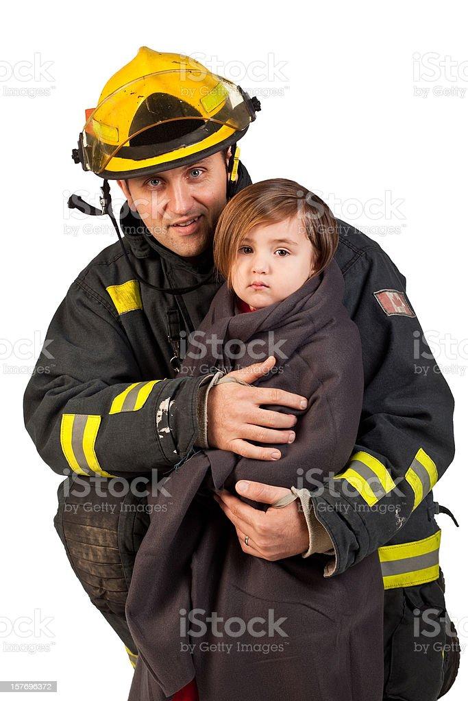 Fireman holding little girl wrapped in blanket. stock photo