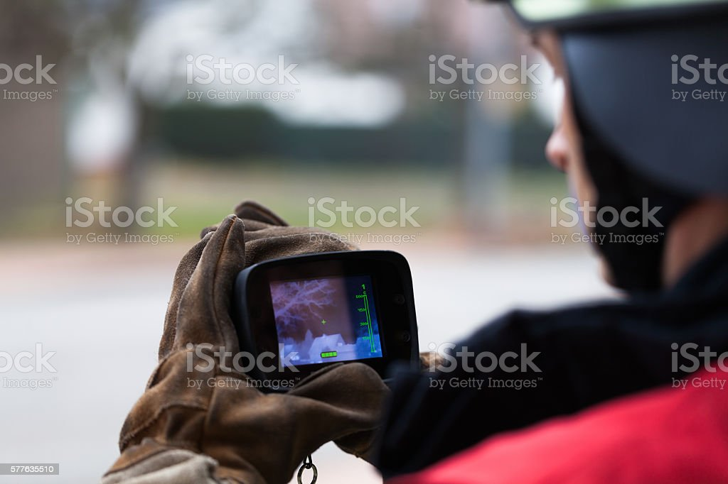 Fireman in action with the thermal imager stock photo