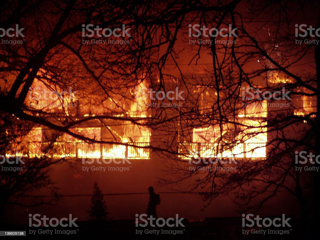 Fireman in front of burning building stock photo