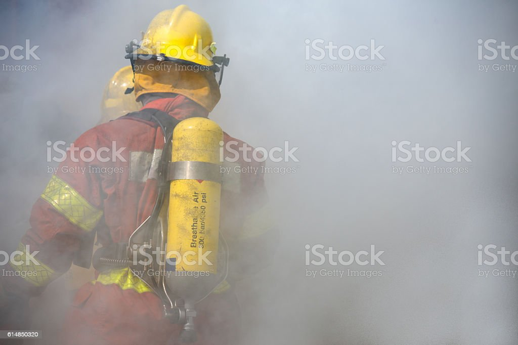 fireman in operation surround with smoke stock photo