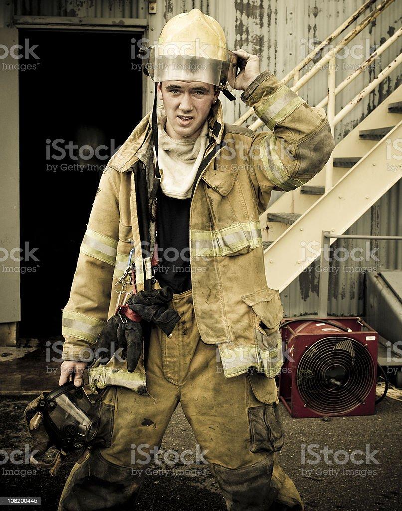 Fireman putting on a helmet royalty-free stock photo