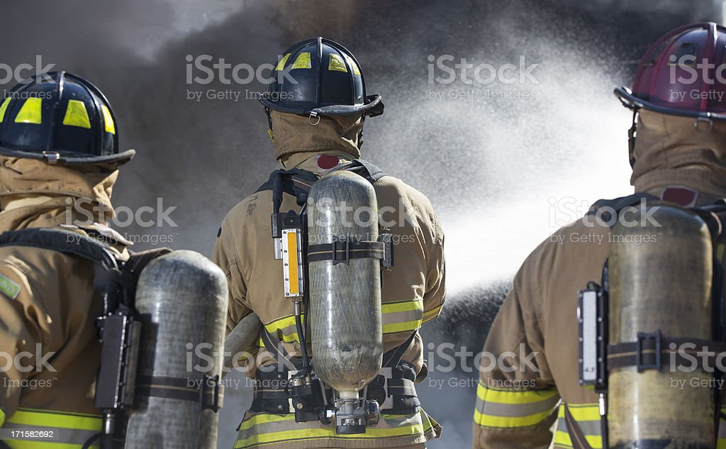 Fireman putting out a bedroom fire stock photo