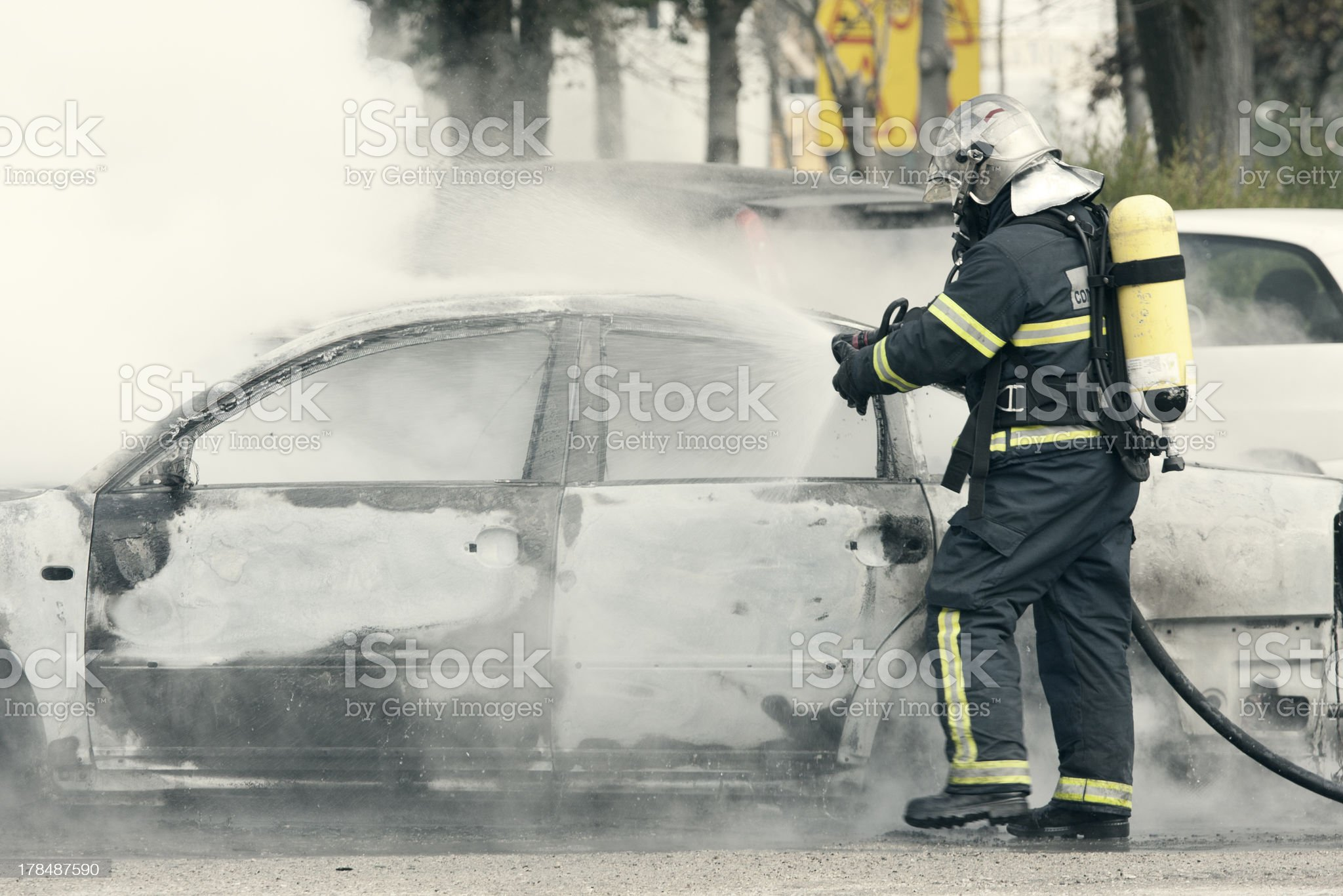 fireman putting out royalty-free stock photo