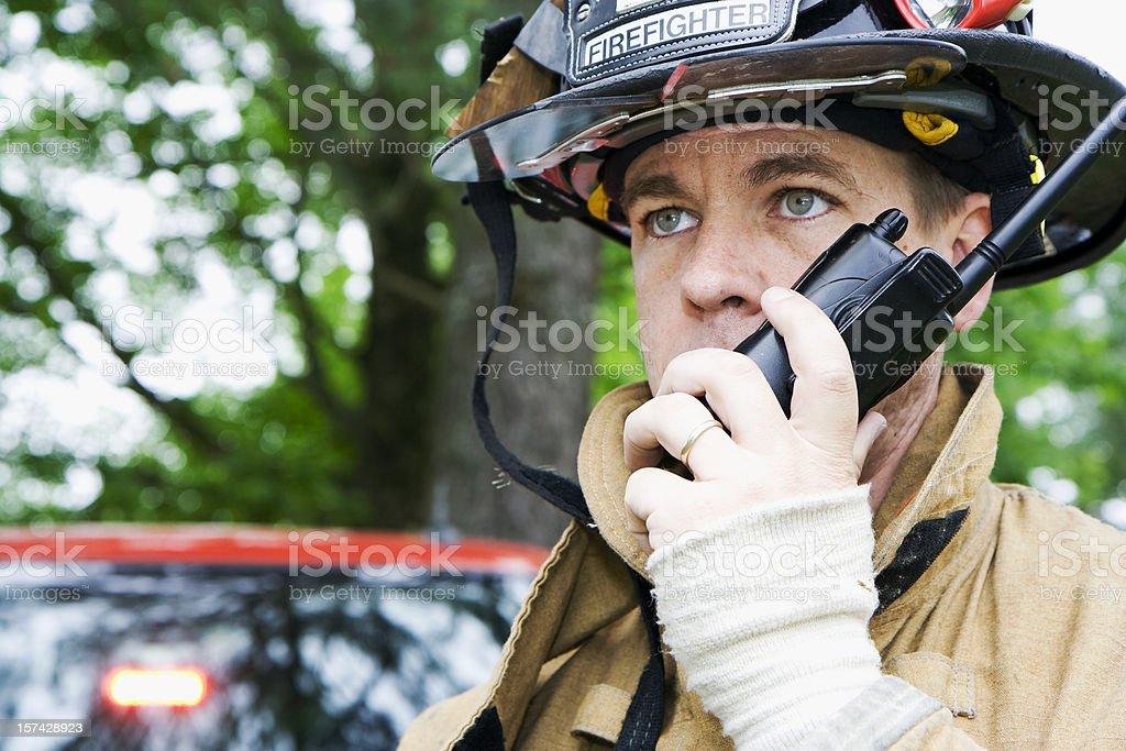 Fireman talking on radio stock photo