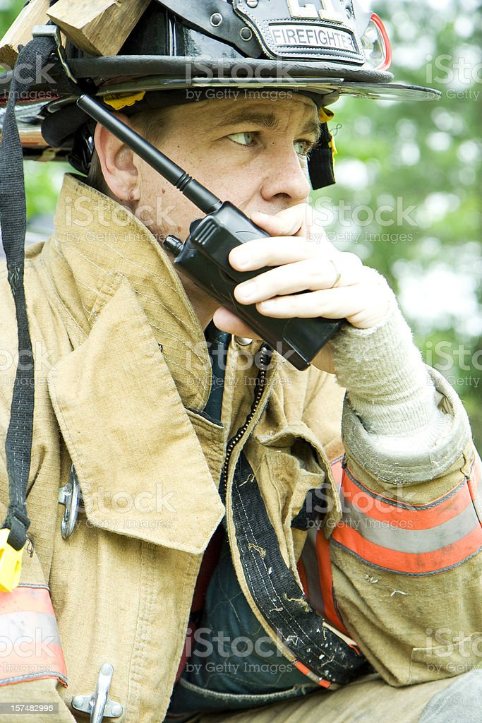 Fireman talking on radio stock photo