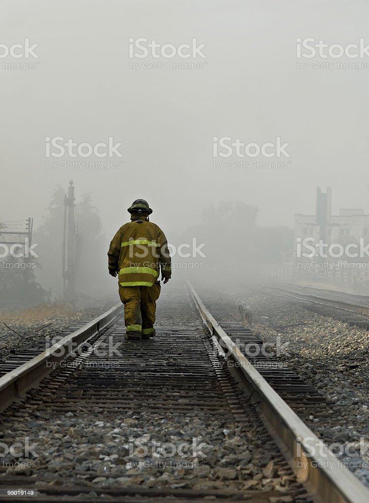 Fireman Walking Rails royalty-free stock photo
