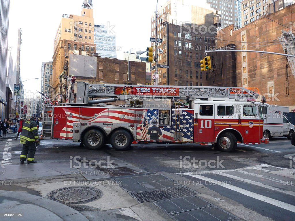 NYFD Fireman with fire department truck in new york stock photo