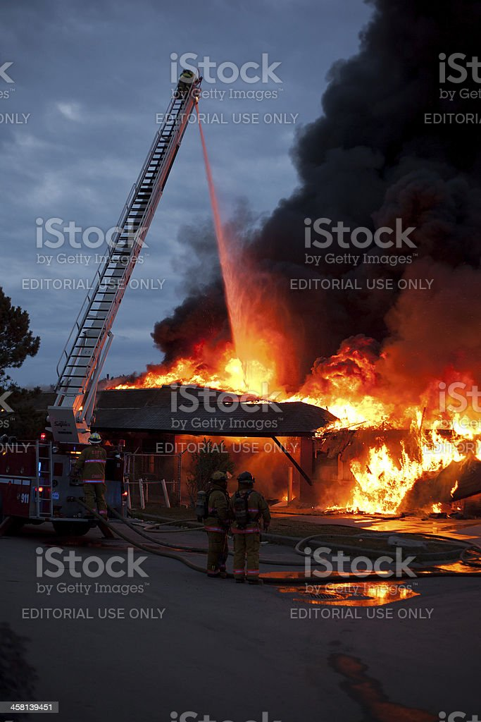 Firemen at Structure Fire stock photo