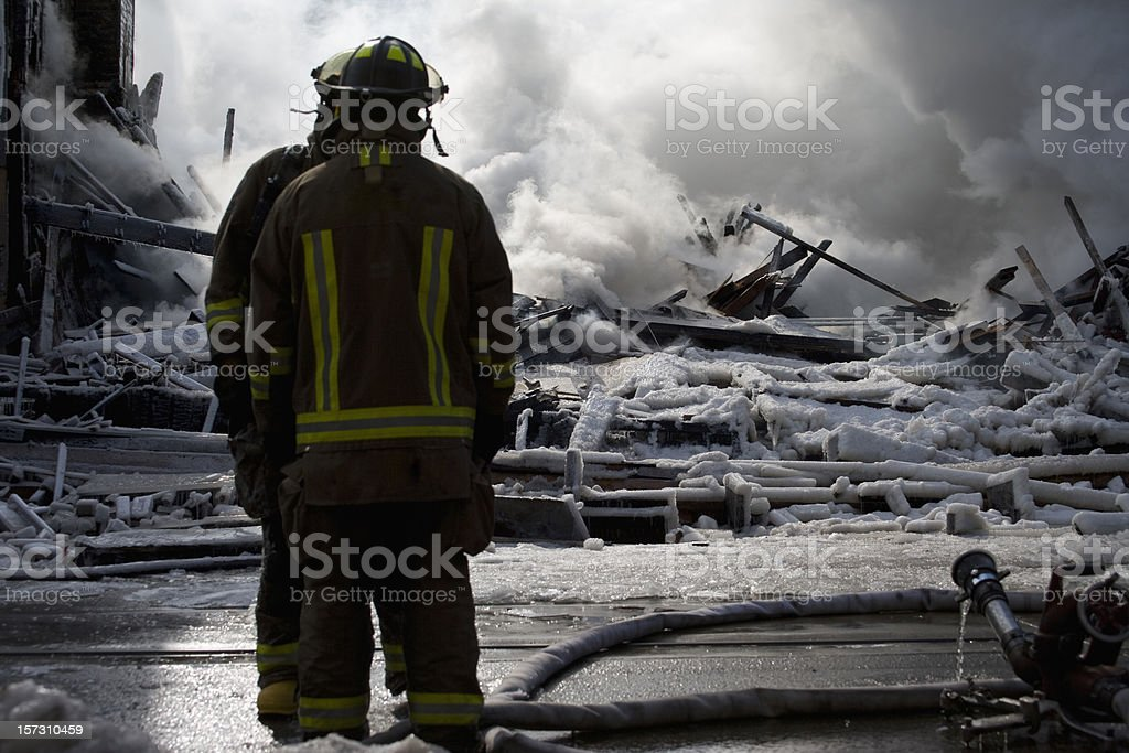 Firemen at the Disaster stock photo