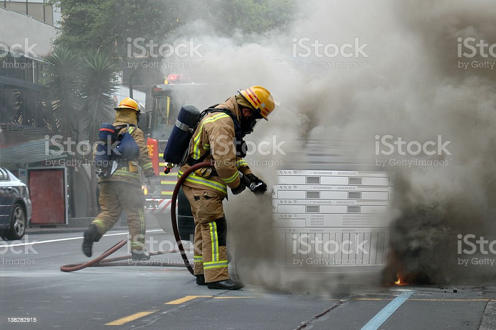 Firemen attending a Hot Server call-out royalty-free stock photo