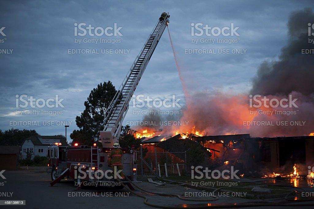 Firemen Battle Blaze from Ladder Truck royalty-free stock photo