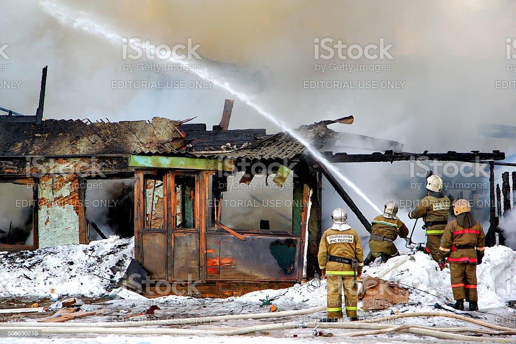 Firemen extinguish a fire stock photo