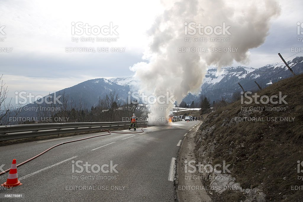 Firemen fight blazing car royalty-free stock photo