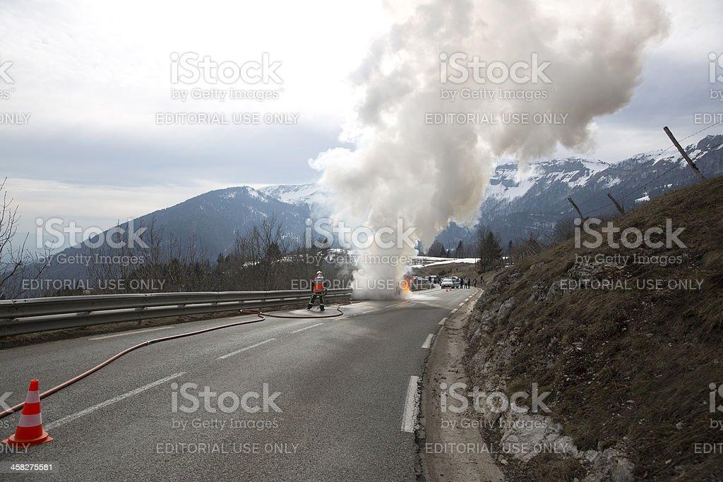 Firemen fight blazing car stock photo