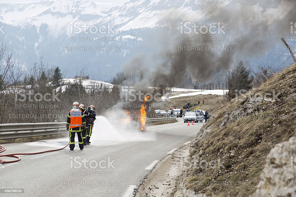 Firemen fight car fire stock photo