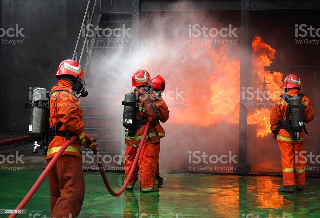 Firemen fighting the fire stock photo