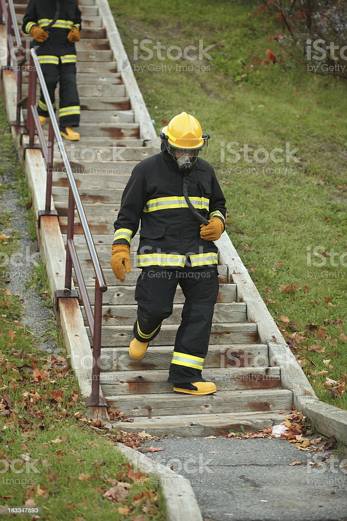 Firemen in training stock photo