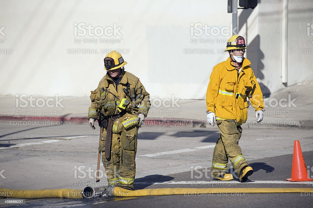 firemen on city street royalty-free stock photo