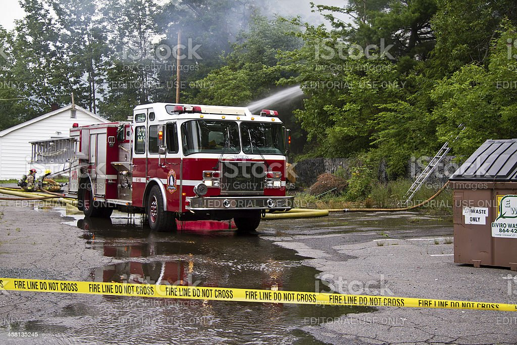 Firemen on Scene of House Fire stock photo