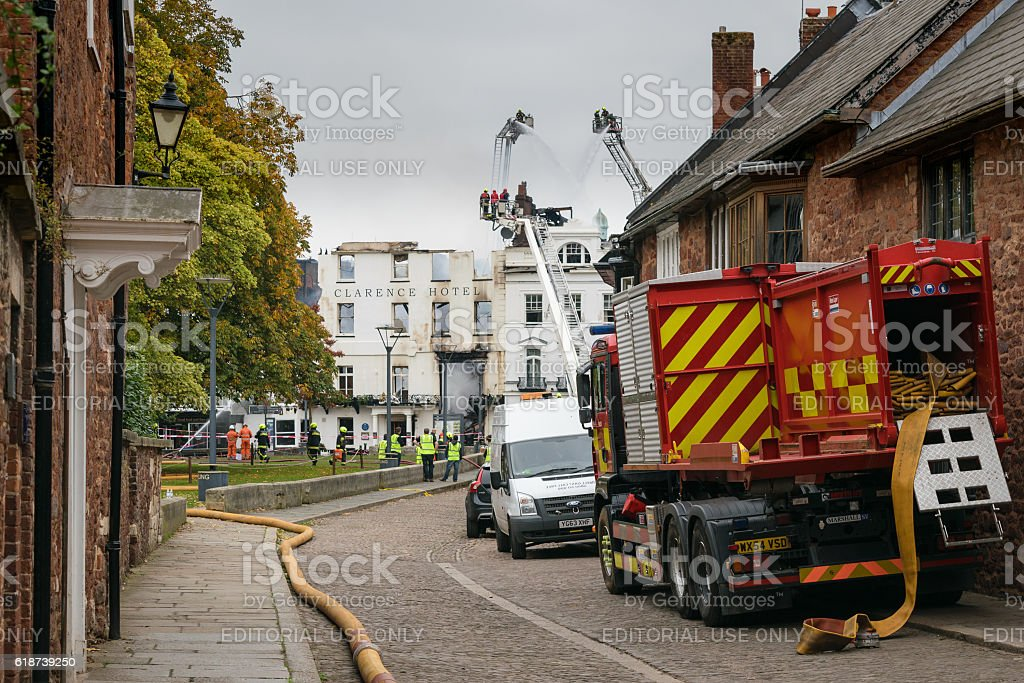 Firemen put out the fire at Royal Clarence Hotel stock photo