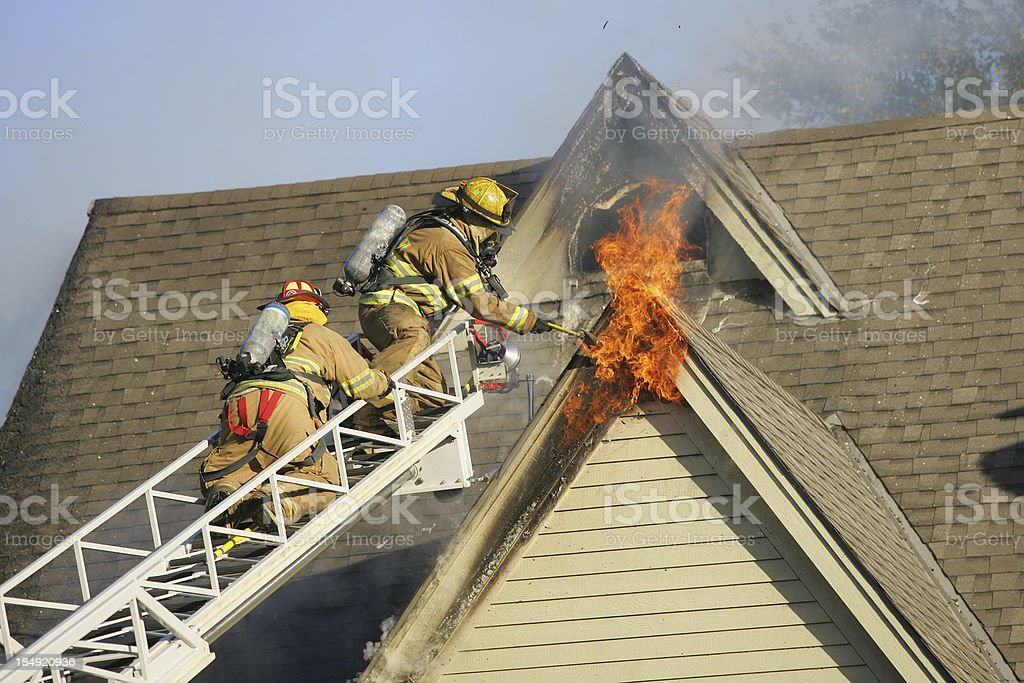 Firemen putting out fire stock photo