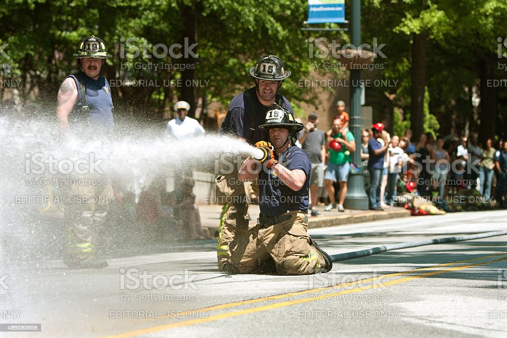 Firemen Shoot Water At Target In Atlanta Muster Competition stock photo