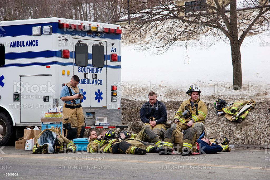 Firemen taking a break stock photo