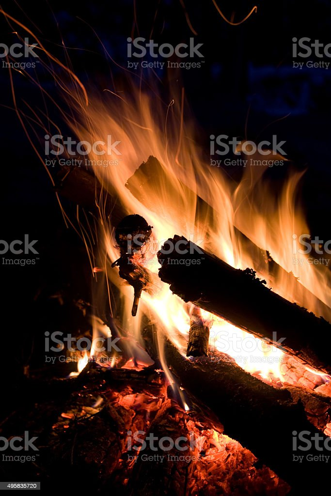Firepalce with sparks in mountains stock photo