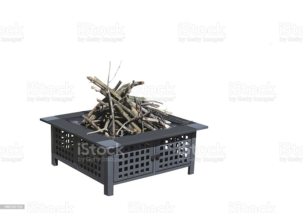 Firepit with logs for fire.  Clipping path.  Isolated on white. royalty-free stock photo