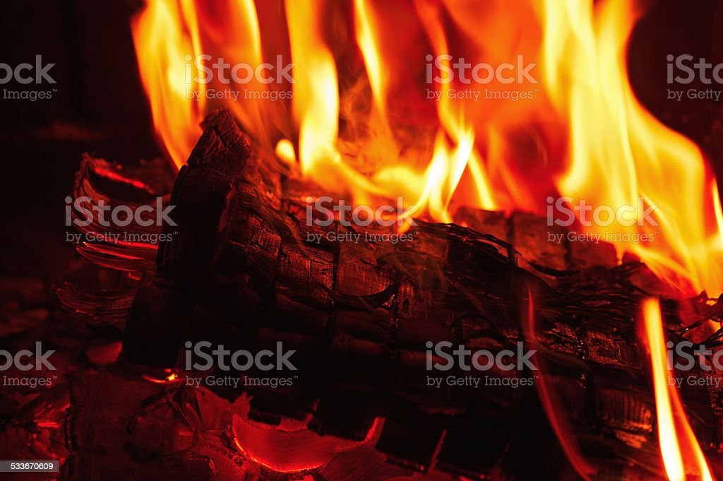 Fireplace burning. Warm burning and glowing fire in fireplace. stock photo