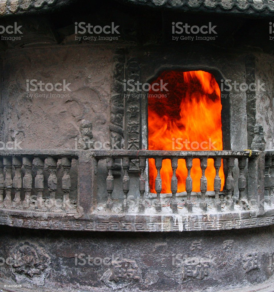 fireplace for burning sacrificial money in Buddhist temple stock photo
