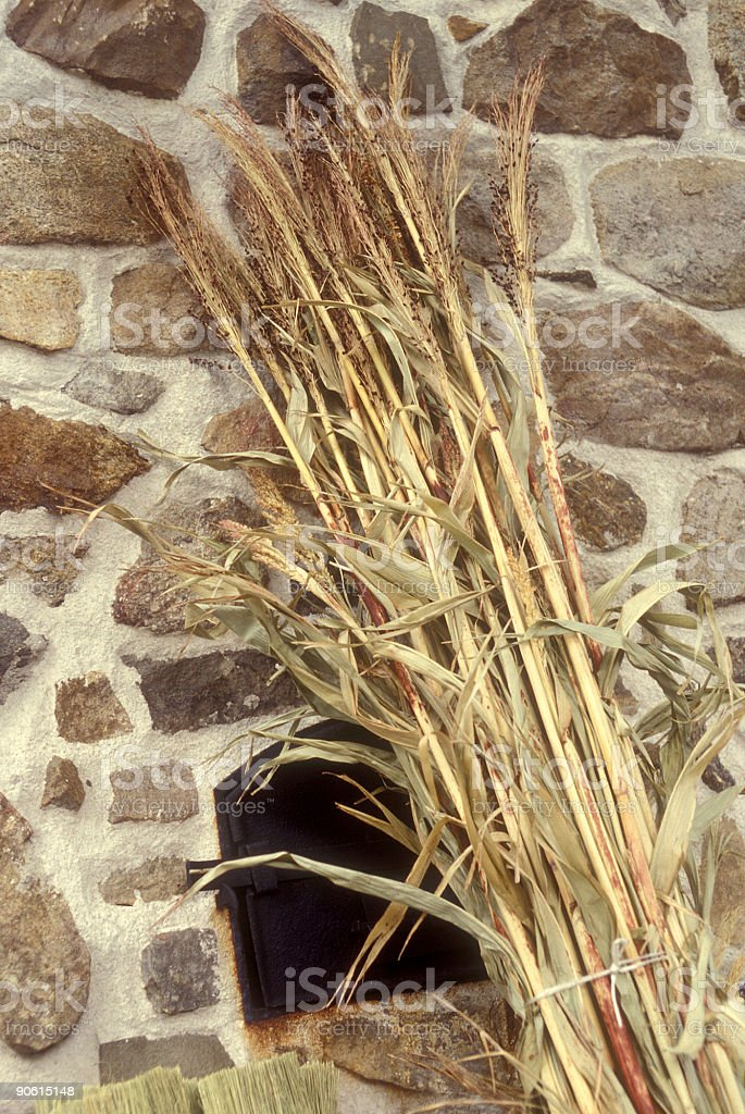 fireplace hearth and reed bundle stock photo