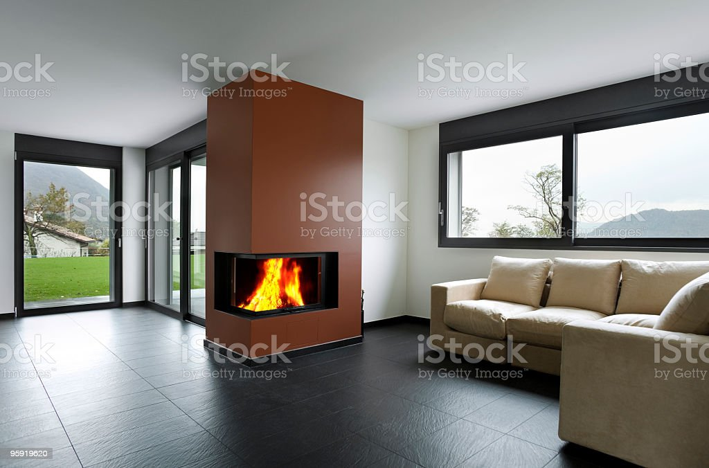 Fireplace in living room in the mountains royalty-free stock photo