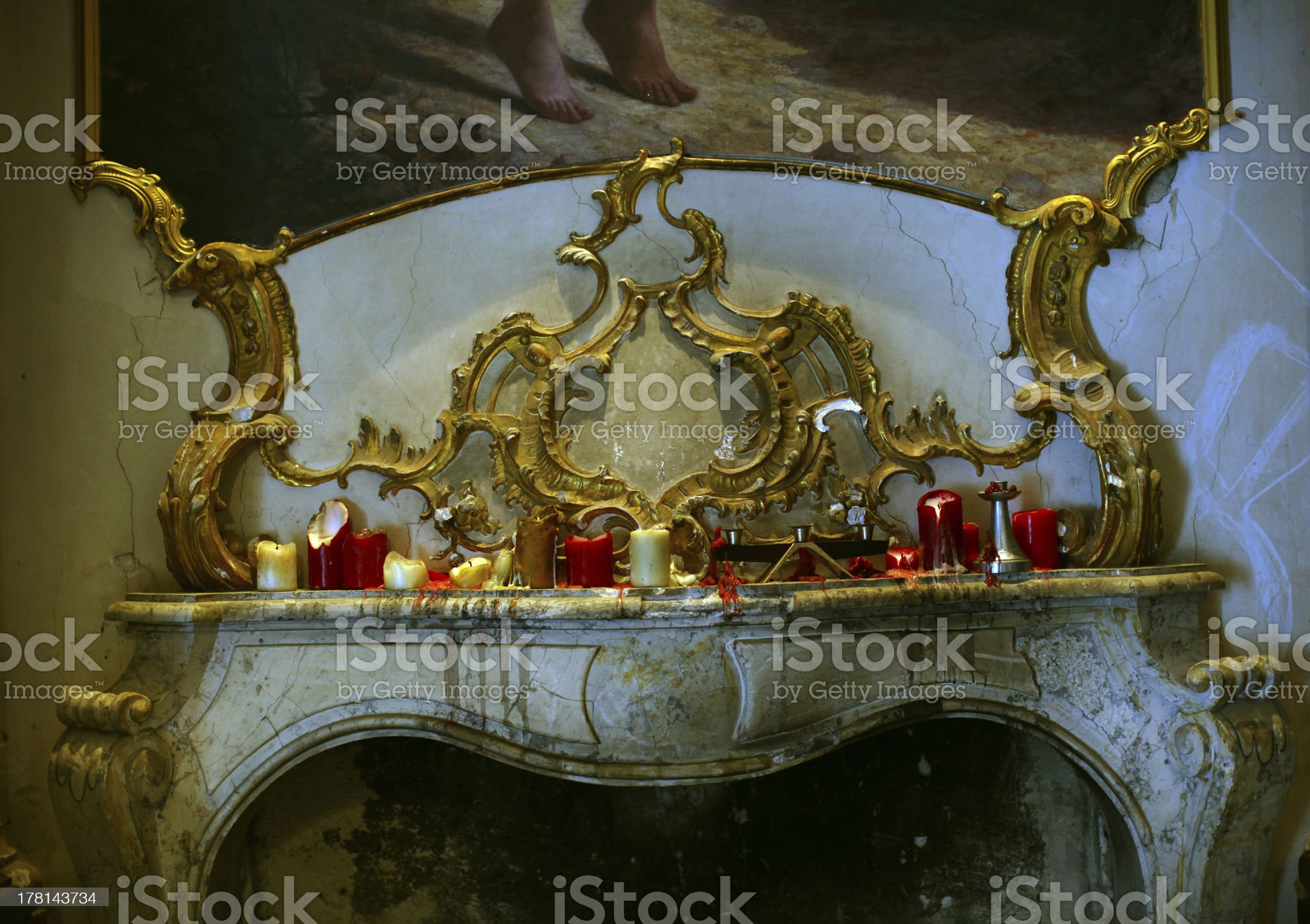Fireplace mantel or mantelpiece made of marble with candles royalty-free stock photo