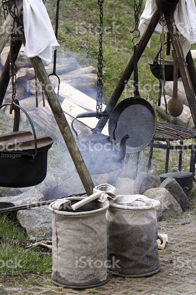 Fireplace on a medieval market stock photo