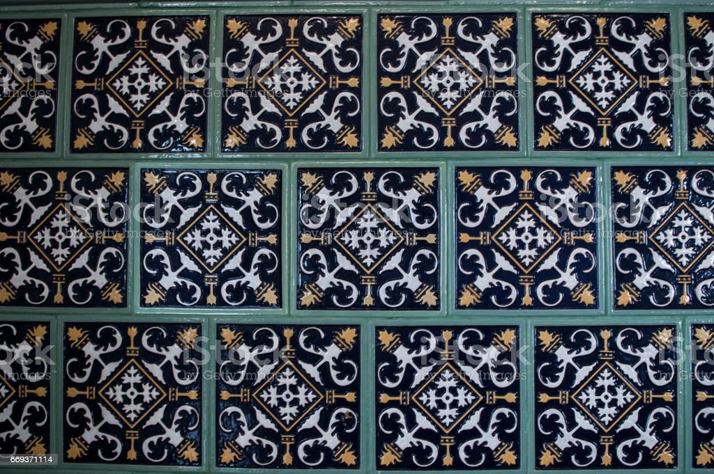 Fireplace with decorative tile stock photo