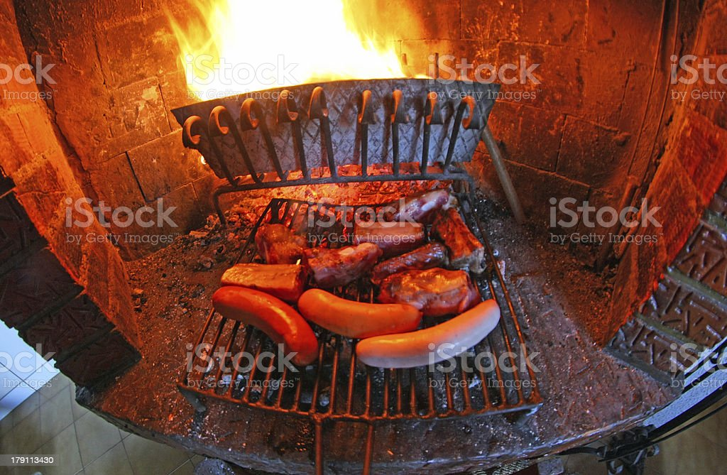 fireplace with fire lit and barbecued meat stock photo
