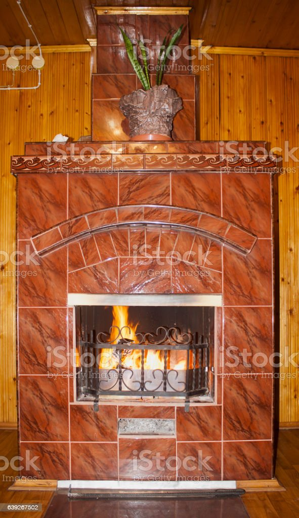 fireplace with flame stock photo