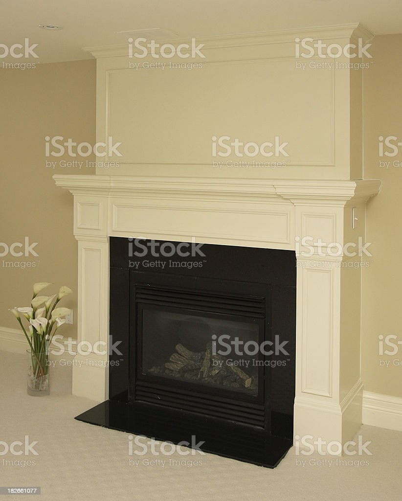 Fireplace with flowers royalty-free stock photo