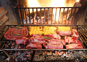 fireplace with lots of pork and beef