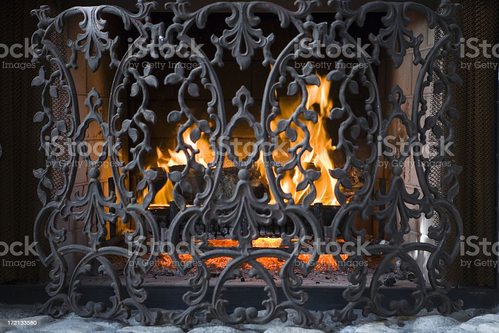 fireplace with wrought iron screen royalty-free stock photo