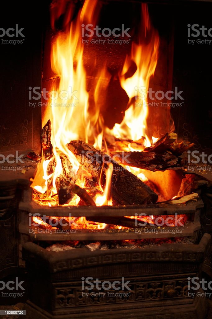 Fireplace with yellow flames from wood fire royalty-free stock photo