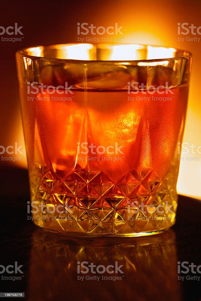 Fireside drink, backlit by the light of  fire royalty-free stock photo