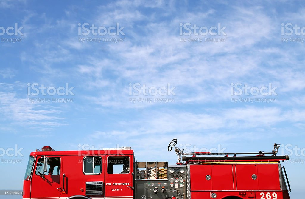 Firetruck against a blue sky stock photo