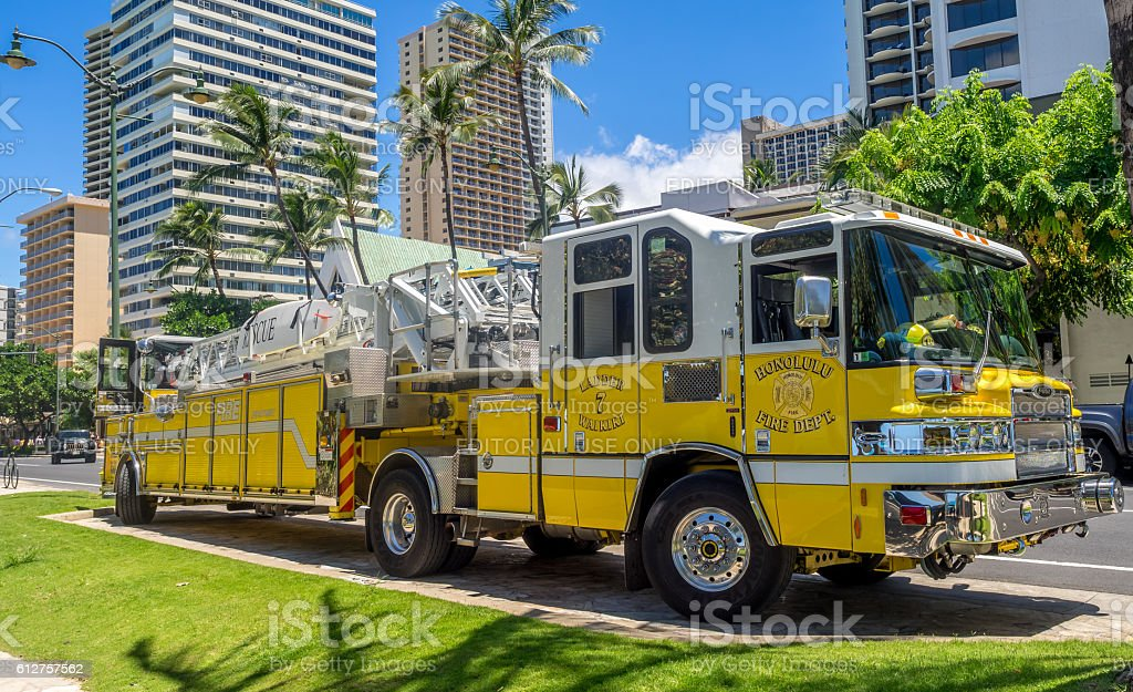 Firetruck along famous on Waikiki beach stock photo