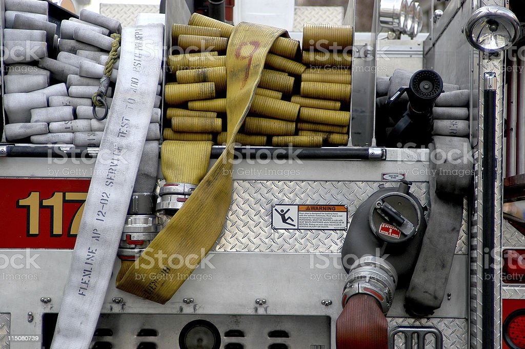 Firetruck and hose stock photo