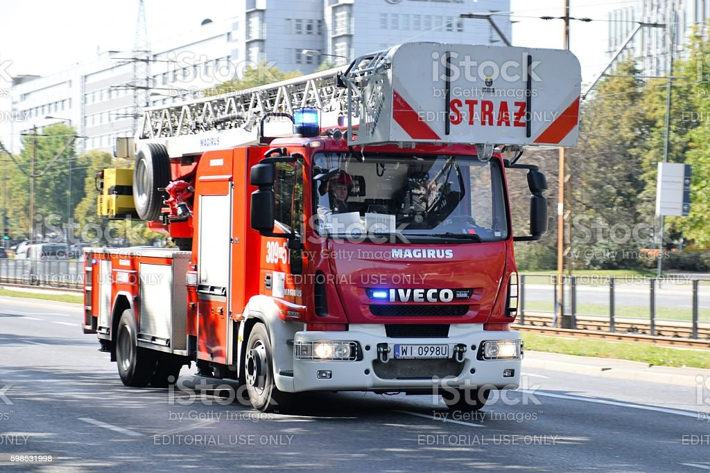 Firetruck IVECO driving on the street stock photo