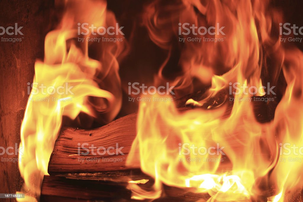 firevood in flames stock photo