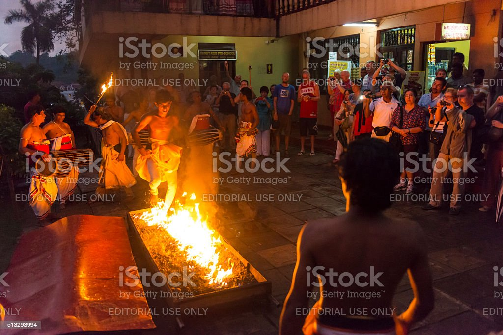 Firewalking in front of Sacred Tooth Relic Temple stock photo