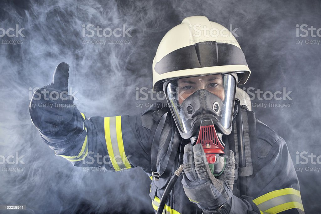 Firewoman in fire protection suit stock photo